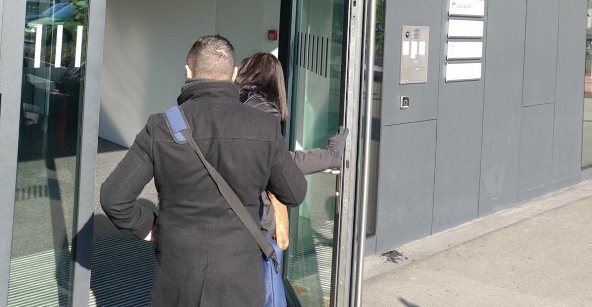 People entering office building hero.jpg
