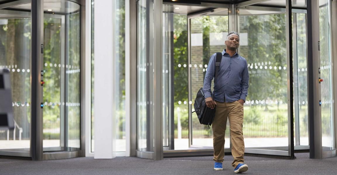Man entering office hero.jpg
