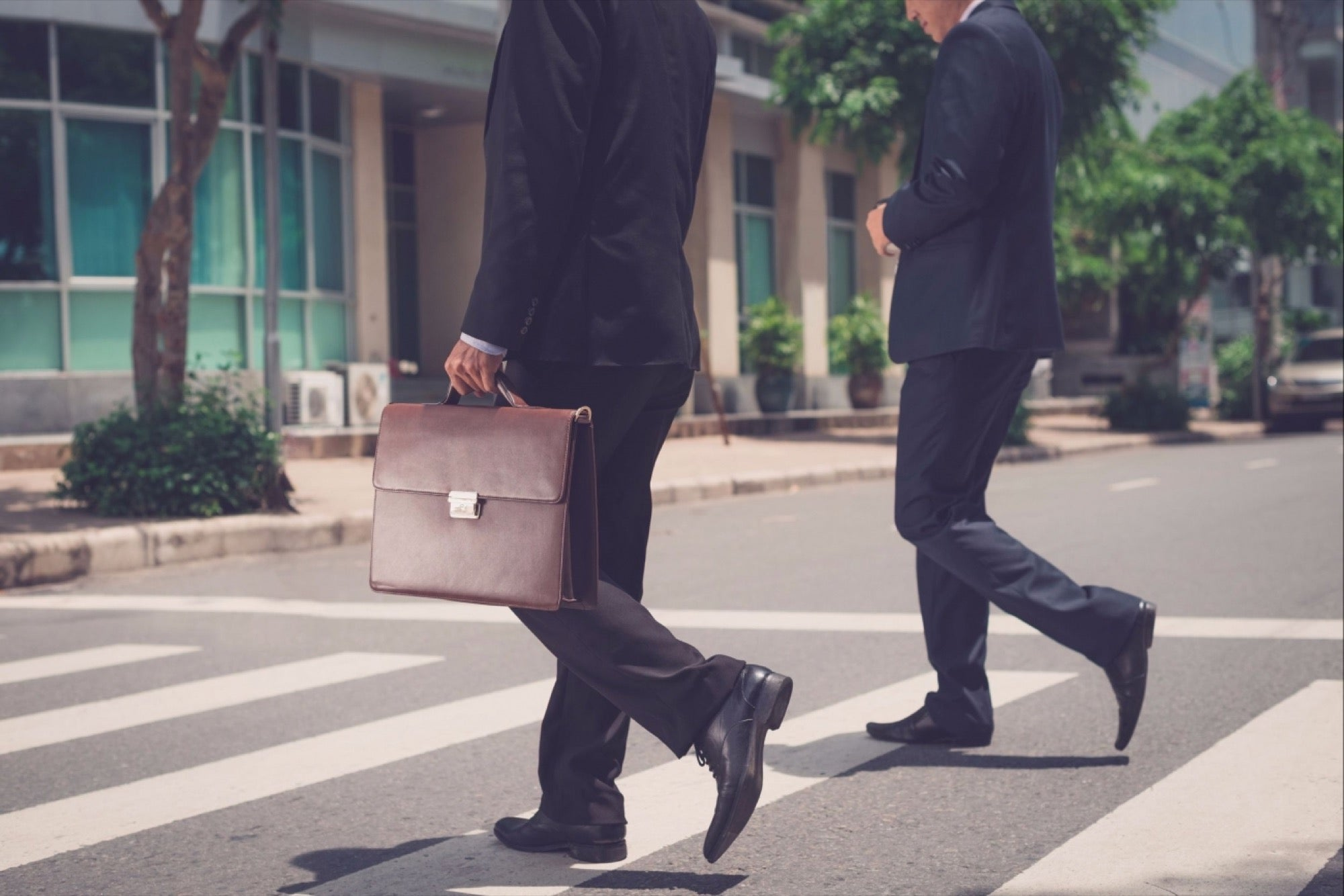20160606131115 businessmen walking suitcase leaving downsizing.jpeg