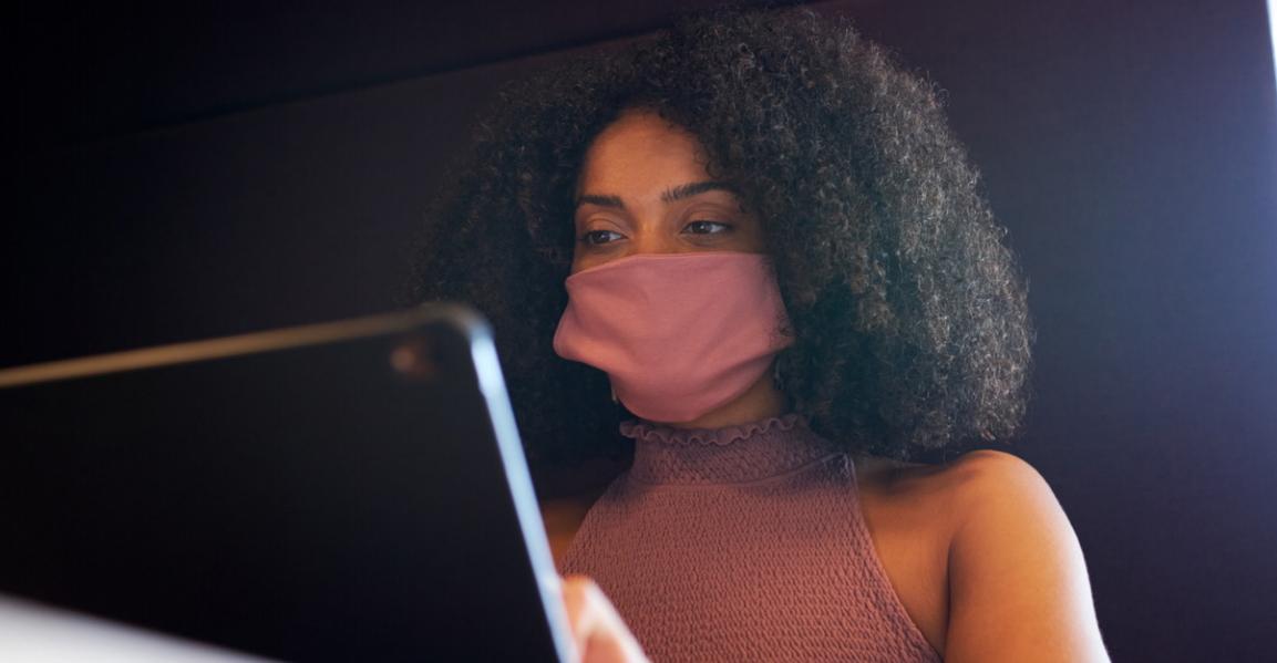 Woman reading laptop mask hero