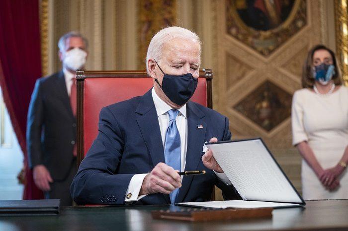 Biden.Signature.Getty_.1.20.21 700x466.jpg