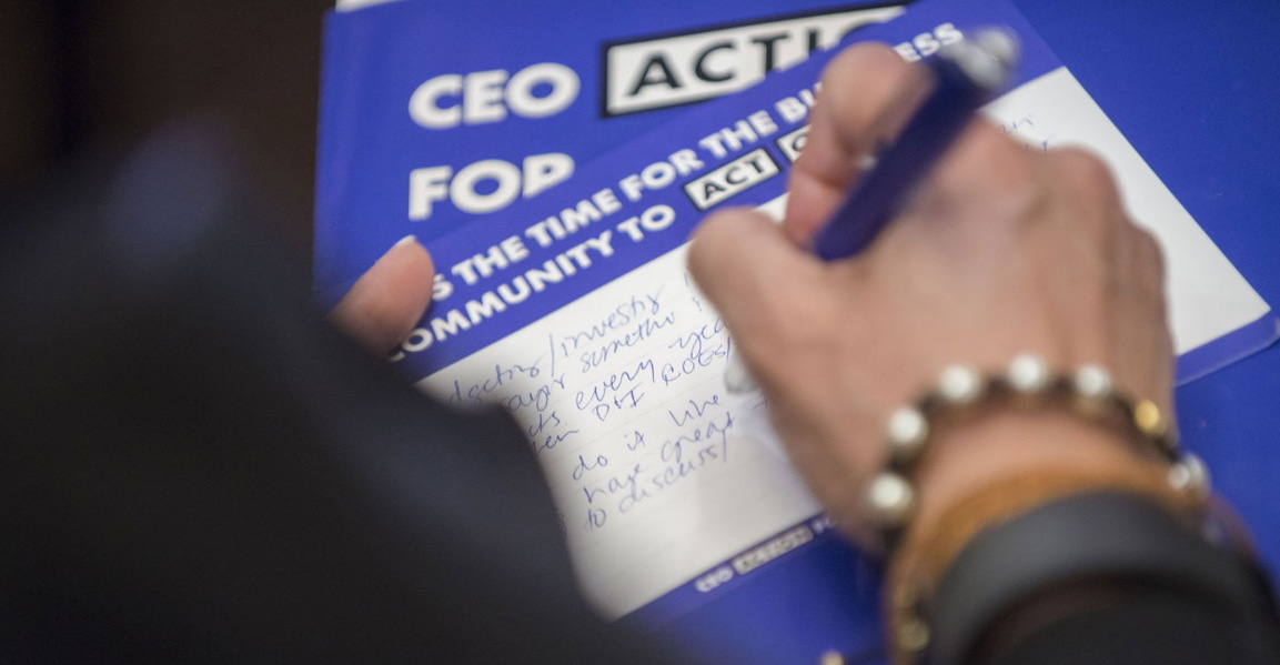 CEO action signing hero