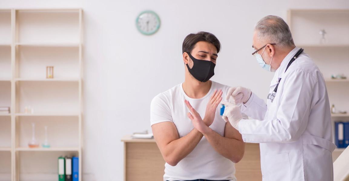 Man refusing vaccine from doctor hero